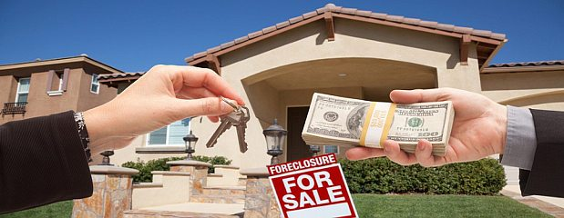Handing Over Cash for House Keys in Front of House and Foreclosure Sign